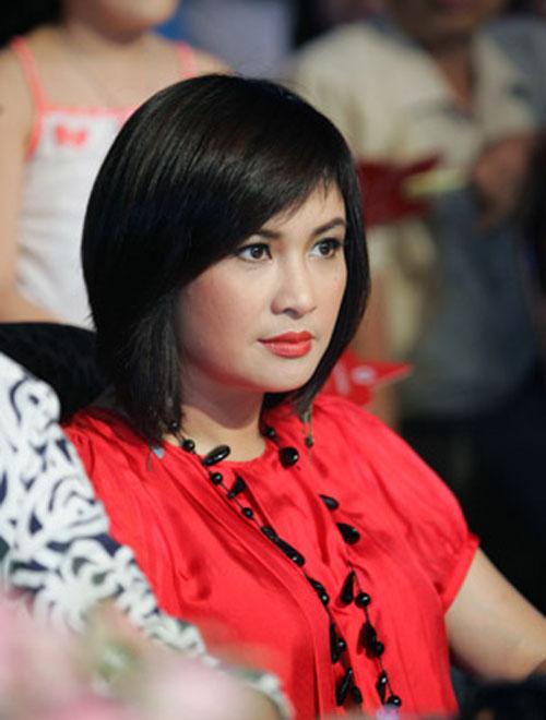 Diva Việt quyến rũ khi diện váy gam đỏ 13